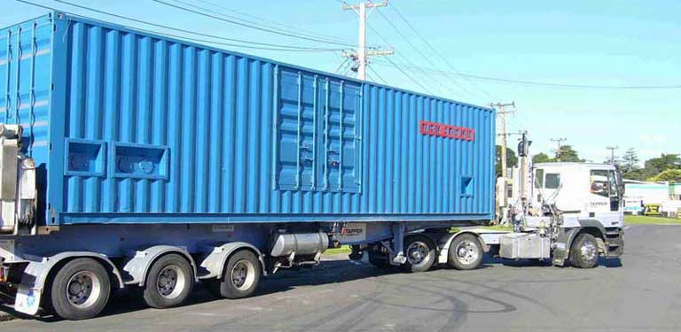 Containerised APG1000 module en route to the port for export to the Philippines